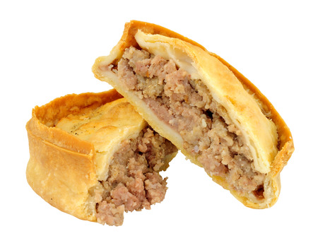 Traditional Scotch meat pie isolated on a white background