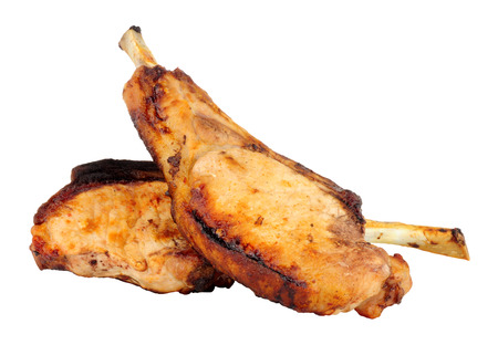 Two grilled tomahawk pork chops isolated on a white background