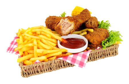 Southern fried chicken portions and French fries meal in a basket isolated on a white background 스톡 콘텐츠