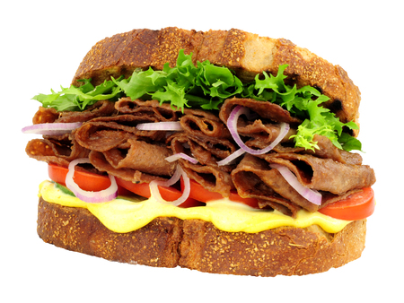 Steak and salad sandwich made with thin slices of reformed beef and pork meat isolated on a white background Banque d'images - 123313010