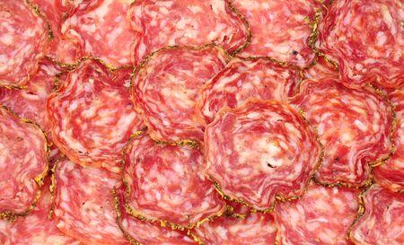 Saucisson Sec French seasoned pork salami meat slices background Фото со стока