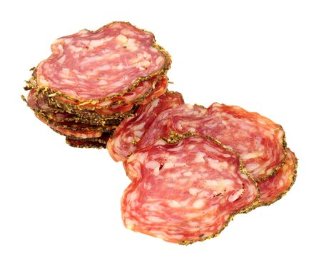 Saucisson Sec French seasoned pork salami meat slices isolated on a white background Фото со стока