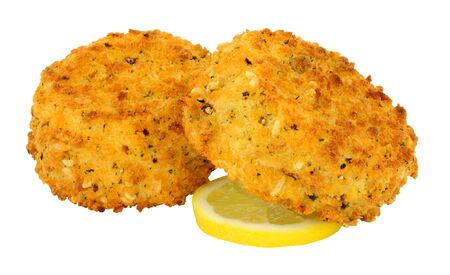 Breadcrumb covered salmon fish cakes isolated on a white background