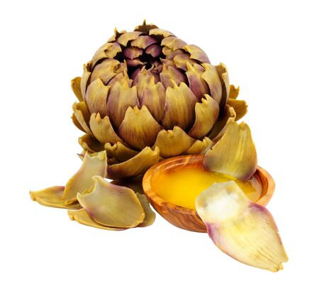 Steamed green globe artichoke flower bud with bowl of melted butter isolated on a white background