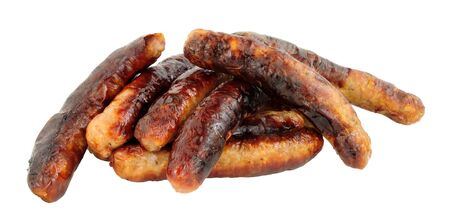 Group of grilled chipolata sausages isolated on a white background