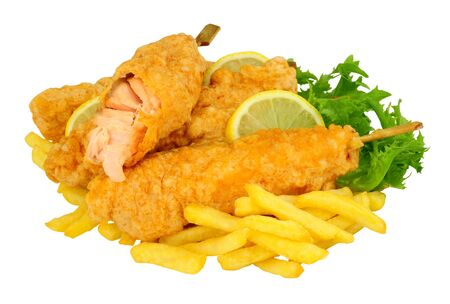 Battered salmon fish fillets on wooden skewers with French Fries isolated on a white background