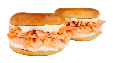 Salmon and cream cheese filled bagels isolated on a white background