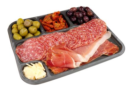 Tray selection of Italian antipasti with plump olives, sweet tomatoes, smoky and garlic infused meats and tangy cheese isolated on a white background Stock Photo