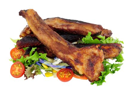Grilled pork ribs with fresh salad isolated on a white background Stock Photo