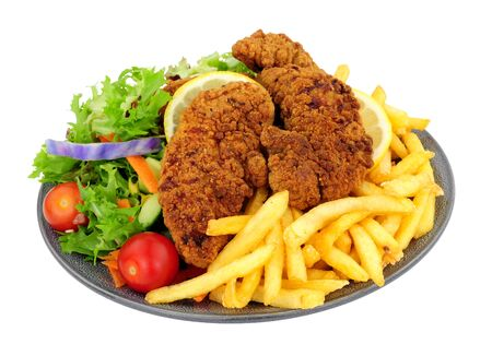 Southern fried chicken and French fries meal with fresh salad isolated on a white background