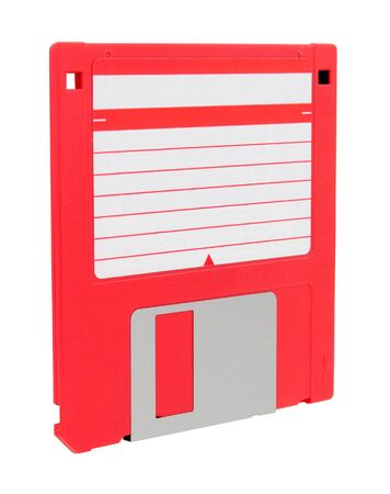 Red 3.5 inch compact floppy disk with blank label isolated on a white background Stock Photo