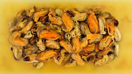 Delicious cooked vinegar preserved pickled mussels background