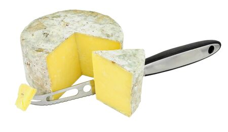 Cave aged farmhouse cheddar cheese with a cheese knife isolated on a white background