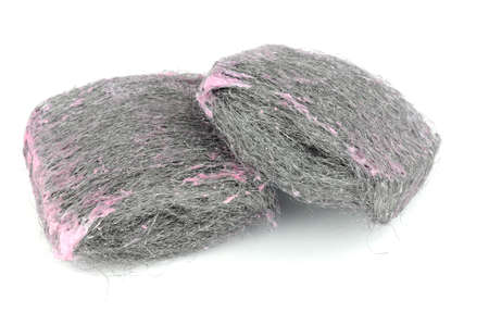 Soap filled wire wool scouring pads isolated on a white background