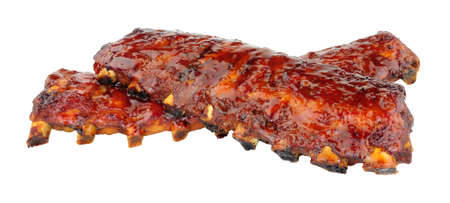 Chinese Peking style pork ribs coated with sticky plum sauce glaze isolated on a white background