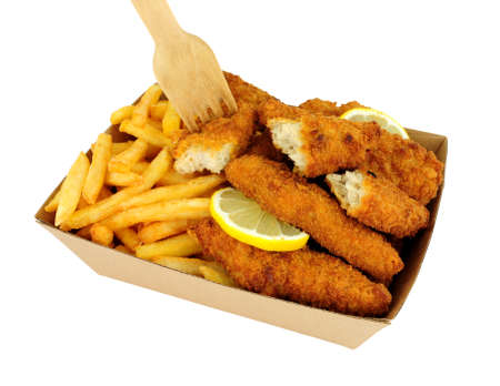 Breadcrumb covered chicken mini fillets and French fries in a cardboard takeaway tray isolated on a white background