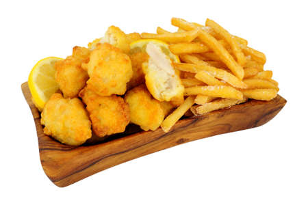 Tempura battered chicken nuggets and French fries in an olive wood serving dish isolated on a white background