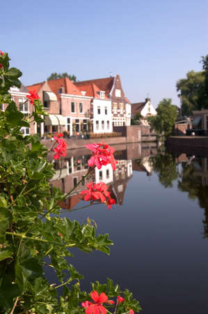 traditionally dutch: Spaarndam - A View Through the Geraniums Stock Photo