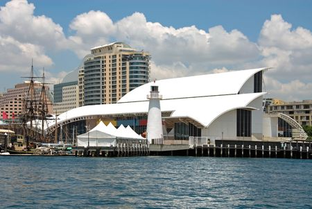 A view of the Sydney Maritime Museum, captured from on board a boat on Darling Harbour, Sydney, Australia photo