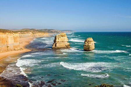 Two of the Twelve Apostles - a series of limestone stacks on the shoreline in Southern Victoria, is one of Australias premier tourist attractions photo