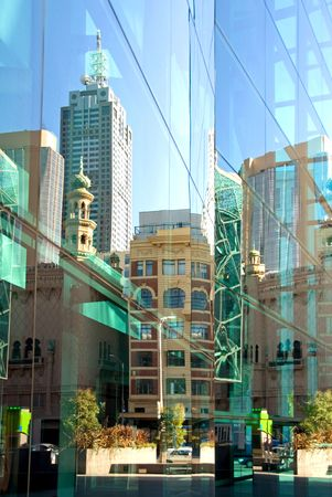 A street scene, reflected in the glass facade of a nearby inner-city office building, Melbourne, Australia