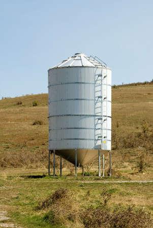 paddock: A grain silo in a paddock