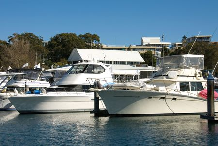 tiedup: Pleasure cruisers berthed in Nelson Bay Harbour, Port Stephens, New South Wales, Australia