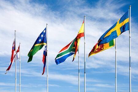 National flags on display beside Lake Burley Griffin, Canberra, Australia photo