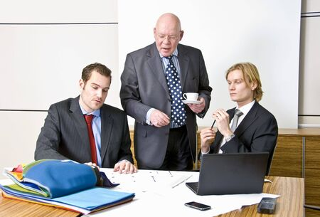 A company director with two of his staff Stock Photo - 4214436