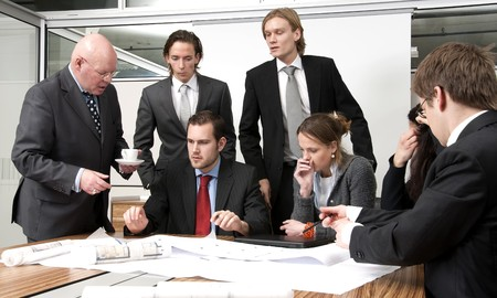A company manager, and his team, discussing plans during an office meeting Stock Photo - 4251205