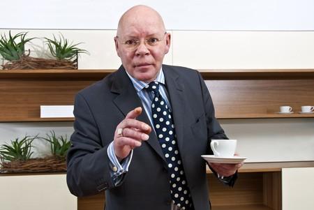 authoritative: An authoritative boss directing his vision straight ahead Stock Photo