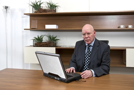A company director typing on his laptop photo