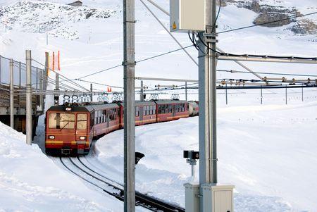 The train that runs from Kleine Scheidegg to the top of Jungfrau, Switzerland photo