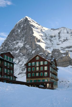 eiger: A hotel in front of the mighty Eiger mountain, Grindelwald, Swizterland Stock Photo