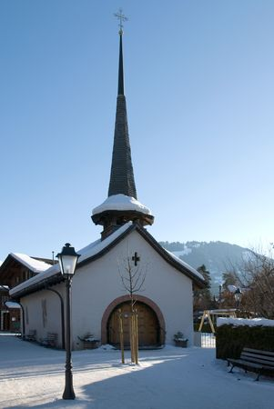 A tiny chuch in the Swiss winter resort of Gstaad photo
