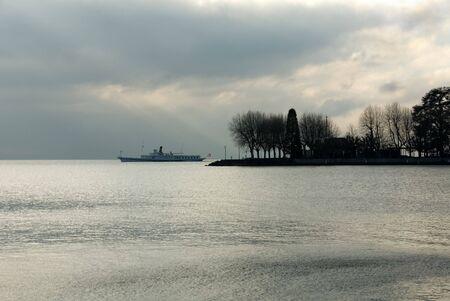 leman: A passenger ferry on Lac Leman, near Geneva, Switzerland, on a cold, dull, winters day.