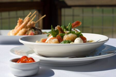 King Prawns, served with Roasted Cherry Tomatoes, Bocconcini, Freshly Slice Chilli, and Basil Leaves photo