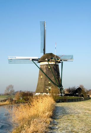 A typical Dutch windmill, near Den Haag, the Netherlands photo