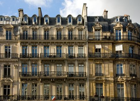 old building facade: A Parisian apartment building near the River Seine, Paris, France