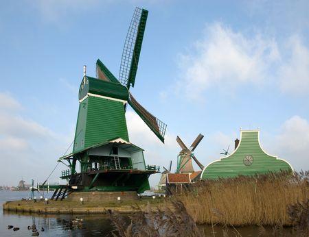 wind powered building: Traditional dutch windmills in the quaint village of Zaanse Schans, the Netherlands