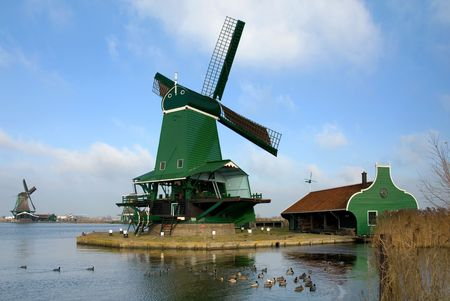 traditionally dutch: Traditional dutch windmills in the quaint village of Zaanse Schans, the Netherlands
