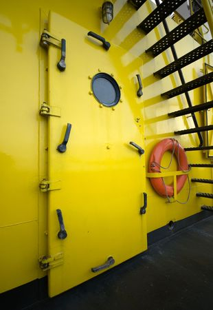 watertight: A water-tight door and life buoy on a fire-fighting tug boat Stock Photo