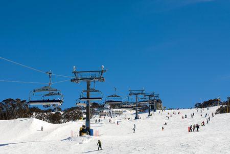 Snow skiers at Perisher Valley, Kosciuszko National Park, New South Wales, Australia