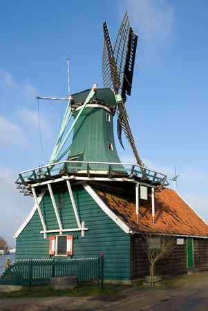 traditionally dutch: A Traditional Dutch windmill in the quaint village of Zaanse Schans, the Netherlands