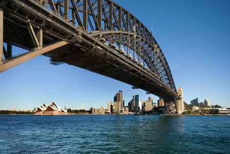 steel arch bridge: The huge steel structure of the Harbour Bridge, with the Opera House in the background, Sydney, Australia