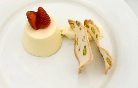 pannacotta: Almond Pannacotta, served with Creme Fraiche and Pistachio Wafers Stock Photo