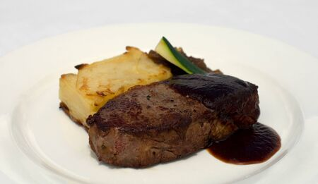 jus: Pasture-fed Sirloin, served on a Potato Galette, topped with Onion Jam and Shiraz Jus