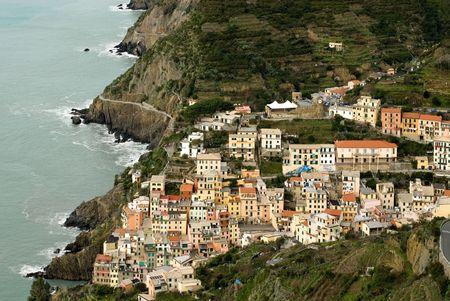 The quaint, picturesque fishing village of Riomaggiore, Cinque Terre, Italy photo