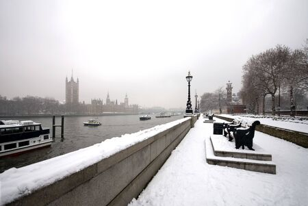The Palace of Westminster, the River Thames, and an adjacent walkway, on a cold Winters day, London, England photo