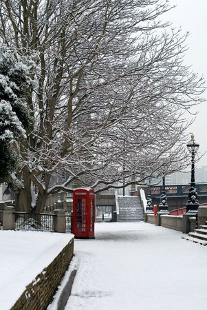 phonebooth: A red telephone box beside a walkway, on a cold Winters day, London, England. Stock Photo